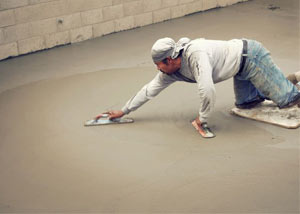 smoothing out the grout in a slab releveling project in Greenville
