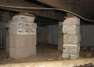 crawl space repairs done with concrete cinder blocks and wood shims in a North Charleston home