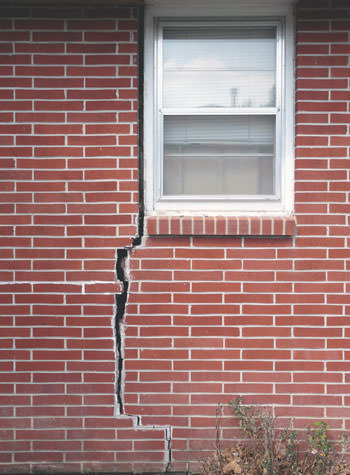 severe foundation wall cracks along a window in Sumter
