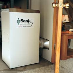 A basement dehumidifier with an ENERGY STAR® rating ducting dry air into a finished area of the basement  in Piedmont